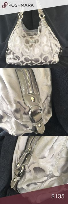 Coach Madison Maggie Op Art Sig. Tote Beautiful Madison Maggie Op Art Signature Tote in Gun Metal Gray 💖 super nice bag . I find only the handles show wear ( shimmer is gone ) , pic upon request. Everything else is in excellent condition!!   This bag was examined by the professionals at Authenticators RUS LLC. And found to be authentic. comes with dust bag and certificate of authenticity. As always buy with confidence! 💃🏽💃🏽💃🏽 Coach Bags