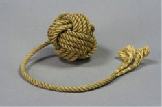 A decorative monkey's fist is a type of knot that is tied at the end of a rope as a weight. The knot is formed around a small weight, such as a stone, or a piece of wood on one end, with an eye splice or bowline on the other, and about 30 feet of line in between. This type of a knot weights the line for an accurate throw between ships and docks. When sailors used this knotted rope as an improvised weapon, it was called a slungshot.