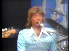 Barry Manilow sings commercial jingles that he wrote.  This is his VSM (Very Strange Medley)....you may not see an image, but click on the play image and you will see and hear the video.