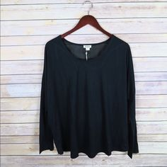 Black long sleeve top Brand: Very J  Size: L Color: Black New  Long sleeve Round neckline  Racerback cutout  50% Polyester 50% Rayon No Trade Tops Tees - Long Sleeve