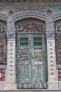 Picture of Worn door frame in Peranakan house