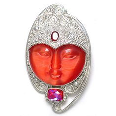 Goddess pin pendant features a 35mm round Orange Fiber Optic face that is framed with silver scroll work. Amid the scroll work are two stones, a 5x7mm faceted oval of Mexican Fire Opal and a 7x10 rectangle of checkerboard faceted Sunset Quartz.
