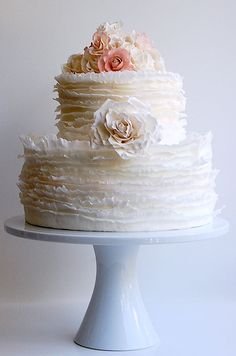 Delicate frills surround this cake topped with sugar roses. Enter the #ProjectDressMe contest: http://ccwed.me/ProjectDressMe