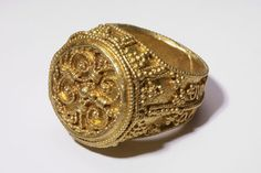 """This most spectacular item is a stunning gold ring with a lozenge-shaped bezel set with a garnet gem which is in near-perfect condition.Anglo-Saxon 7th century AD. """"TAKE A LOOK AT THIS"""" !!"""