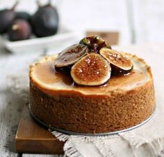 Recipe for cheesecake made with tangy yogurt cheese and topped with figs in a candied honey sauce.