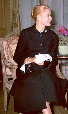 Princess Grace in her Paris flat holding her Hermès Kelly, September, 1956.