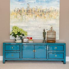 A sophisticated low cabinet for media storage or living storage which will bring a pop of ocean blue to a room. The central double cupboard houses a single removable shelf, flanked by four drawers each with elegant solid brass tab handles. Place this lovely low cabinet under a wall mounted TV, for media storage, or in an entrance hall for useful compact storage.