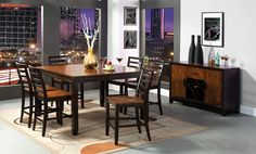 """9 Pc. San Isabel II Counter Height Acacia Plank Espresso Wood Finish Table Top And Legs. This elegant two toned dining table is made of acacia woods, and has seating for eight . The """"Plank"""" style table and buffet top add a special designer quality to the set. The dining chairs have a wooden contour seat. Butterfly leaf measures: 12"""". The dining table set contains: (1) Dining table measures: 54""""(42""""+1 x 12""""Leaf)L x 54""""W x 36""""H, (8) Counter height chair measures: 19""""W x 23""""D x 41""""H."""