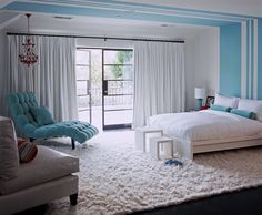 Designer Betsy Burnham filled this bedroom for a preteen girl with white bedding, a white rug and chair and white curtains, then added just one piece of furniture, a bit of paint and a few accessories in the girl's current favorite color. The room can easily (and affordably) take on a new look if her taste in colors changes as she grows.