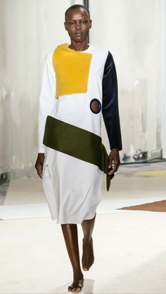 """JACQUEMUS FALL RTW 2015 Employing more of a variety of fabrics, this look represents jaquemus""""s approach to piecing together elements to create a more interesting silhouette."""