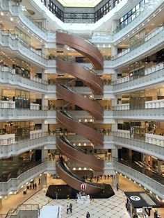 World's largest spiral escalator - New World Daimaru Department Store, Shanghai By karma_is_kool Spiral Stairs Design, Spiral Staircase, Staircase Design, Concept Architecture, Facade Architecture, Beautiful Architecture, Shopping Mall Architecture, Shopping Mall Interior, Atrium Design