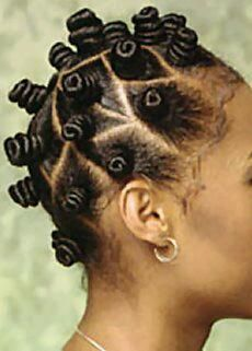 [Bantu/Zulu knots] Styling techniques/tools used: No tools are used for this one, just twist hair starting at scalp and tie it.  Aveda products: pure abundance style prep, brilliant retexturing gel, witch hazel.