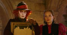 A still from the Alice Through the Looking Glass Trailer with Alice and the Mad Hatter: In the new movie Alice returns to Wonderland to stop Time (literally) and rescue the Mad Hatter.
