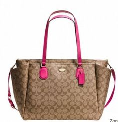 """****USE PROMO CODE """"GIFT25"""" TO GET $25 OFF YOUR FIRST TRADESY PURCHASE OVER $199****. This authentic Coach baby bag is made of signature coated canvas with pink leather trim. Roomy and chic this bag doubles as a weekend travel bag as well. It features zip-top closure, gold tone hardware, fabric lining, outside open pockets on each end and inner elastic pockets to keep it all organized. It comes with a washable diaper pad and adjustable carrying strap. The handles drop is 9 1/2"""" and the…"""
