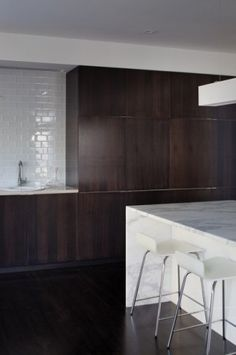 dark wood, marble countertop and subway tile.