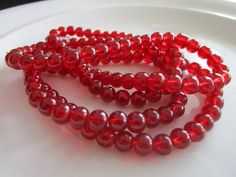 138 round Glass Beads burgundy red COLOR 4mm bead by LeeliaDesigns