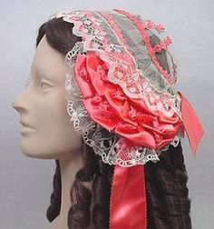 Lovely 1850's cap.  What makes it 50's is the focus on the side of the face, not at the top of the head.