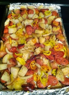 Oven-roasted Sausages, Potatoes, and Peppers  ~ an oven pan laden with delicious food (a LOT of it) that is cost-effective, EASY EASY EASY, and delicious.. this recipe will serve 3-4 adults..