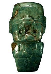 Hache Kunz. Am. Mus. Of Nat. Hist. NY.  The mouth in the shape of a jaguar and the almond-shaped eyes placed on top of the head lead us to surmise that this figure may represent a chief or a shaman who has transformed himself into a jaguar -- the most powerful hunter in the forests of Mexico and Central America -- to partake of its power. With its economical, taut carving, in which not a single line or mark is wasted, the brilliant sculpture is among the finest jade carvings in history.