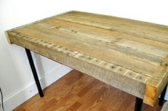 Table made from reclaimed wood and legs from IKEA. It cost less than $20.