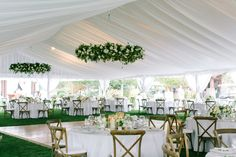 Outdoor tented reception filled with floral chandeliers of crisp white and greenery | Bridalbliss.com | Portland Wedding | Oregon Event Planning and Design | Amanda K Photography