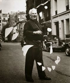 Portrait. Alexander Calder's with one of his mobiles
