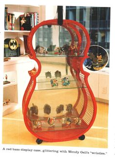 A collection of wristies in a cello showcase. Find Objects, Vinyl Art, Cello, Painting & Drawing, Bookcase, Vintage Jewelry, Shelf, Design Ideas, Paintings