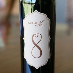 "Wine Bottle Brown Kraft Die Cut Labels - Table Numbers - Wine Bottle Table Numbers. Label size: 5"" x 2.5"". Paper type: self-adhesive label. Variety colors and fonts available. PRICES: 12 labels (Table"