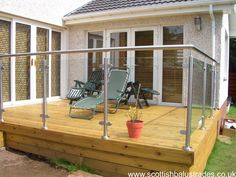 Stainless steel and glass balustrade on decking
