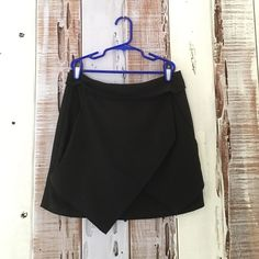 Asymmetrical Black Skirt This is a skirt! When I first bought it, I thought it was a skort. But this is a skirt! Super cute. I paired it with a cropped black t-shirt, gold necklaces, a tan jacket, and tan heels! Fits a 4 and under. Very J Skirts Mini