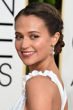 Blush tones, faux bobs and soft metallics - close up on the hair and make-up from the Golden Globes