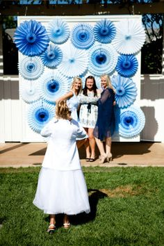 I love this idea of a rosette backdrop. Perhaps outside the boathouse at the entrance?