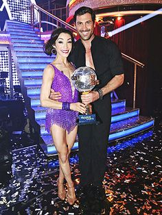 DANCING WITH THE STARS (Season 18) | Up for the mirror ball trophy were season frontrunners Meryl Davis and Maksim Chmerkovskiy, along with Amy Purdy and Derek Hough, and Candace Cameron Bure and Mark Ballas. Bure was eliminated first, followed by Purdy. That meant Winter Olympic gold medal ice dancer Davis took the Dancing crown – and made Chmerkovskiy a first-time pro champ. | Shown: Meryl Davis and Maksim Chmerkovskiy with the mirror ball trophy on May 20, 2014