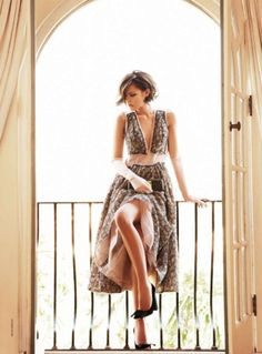 sometimes you just want a chic haircut, a fabulous dress, and a balcony from which people can admire you