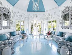 In the octagonal entry hall, Redd suspended a chandelier by Antonson from a ceiling clad in alternating fabrics by Duralee (white) and Perennials (blue).