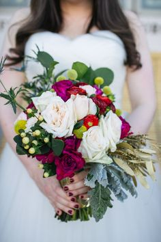 bouquet with a touch of gold, photo by Rachel Whyte http://ruffledblog.com/texas-gemstone-wedding #weddingbouquet #flowers #springwedding