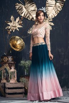 Bottle Green To Peach Ombre Lehenga With Peach Sheer Blouse - Floor length lehenga tinted in bottle green to peach ombre towards the hem with zari embroidered belt. Blouse is covered with green and zari threads in floral pattern. Indian Gowns Dresses, Indian Fashion Dresses, Dress Indian Style, Indian Designer Outfits, Fashion Outfits, Lehnga Dress, Lehenga Choli, Lehenga Blouse, Indian Wedding Outfits