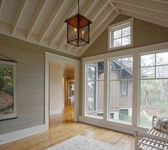 The shiplap walls were painted in Benjamin Moore Bone White. Johnny Ruxton, a local faux painter and artist, applied an antiquing glaze over them to add some gray and brown tint to it. could add pink undertones to it Rustic Cottage, Floor To Ceiling Windows, Open Ceiling, White Ceiling, Ship Lap Walls, Luxury Interior Design, Architecture, Great Rooms, My Dream Home