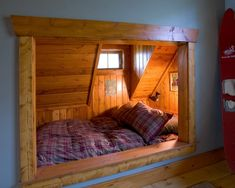 Attic alcove bunk with steep roof angle and eyebrow window. Feels a little closed in.