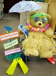 """Teddy bear is ready to read! His signs say, """"It's never to early to start your summer reading!"""""""