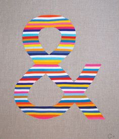 could do this with paint and painter's tape: a letter for the boys room.