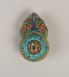Crown Ornament for a Deity 17th–19th century Newari for Tibetan Market Gilt silver, emeralds, sapphires, rubies, garnets, pearls, lapis lazuli, coral, shell, and turquoise