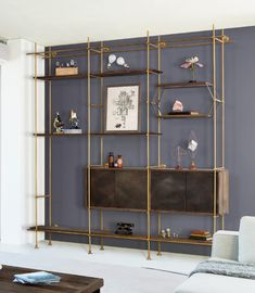 To keep gray pieces from feeling too cool for school, we recommend warming them up with metals. Coppers and golds in particular add inviting shine by bringing out natural warm tones within the. photo Trend Alert: Gray Wood Furniture and Décor Grey Wood Furniture, Furniture Design, Gold Bookshelf, Oak Shelves, Brass Shelving, Living Room Shelves, Shelving Systems, Minimalist Design, Modern Design
