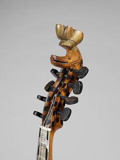 Hardanger Fiddle    Date:      1786  Geography:      Norway  Culture:      Norwegian  Medium:      Wood, mother-of-pearl, bone  Dimensions:      Overall: 62 cm (24 7/16 in.)  Classification:      Chordophone-Lute  Credit Line:      Purchase, Frederick M. Lehman Bequest, 2008  Accession Number:      2008.268