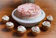 Vanilla gluten free cake with homemade vanilla buttercream. Matching cupcakes with cherry blossoms.