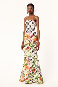 Resort, 2014 runway collection. Stunning strapless evening gown in white with a black plaid pattern and adorned in multi color floral printed appliqués. The dress is dart fitted with a fluted skirt an