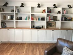 All about how we DIY'd our built in bookshelves using IKEA cabinets. Custom Bookshelves, Office Bookshelves, Bookshelf Wall, Book Shelves, Bookcases, Built In Shelves Living Room, Built In Bookcase, Home Office Cabinets, Ikea Cabinets