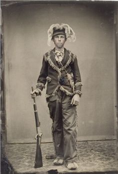 Festive! Tintype portrait of a young hunter in a flamboyant outfit wearing a hat decorated with animal tails (circa 1860-80's). #curiosities #curiosity #history #photo #photos #hunters #hunter #men
