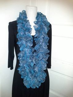 Maiden Long Island's Cowl Ruffle Scarves are hand knit with with love and care. Our cowl scarves are perfect for wrapping around a few times or you can let them hang.  They are light weight and perfect for spring.  Wear these ruffly accessories to add some flair to your work wardrobe or ress up your favorite pair of jeans for a night out, or make it work wear.