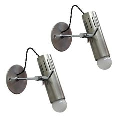 Wonderful pair of French, fully adjustable pivoting lamps by Alain Richard for Disderot, articulating slotted heads with slide option along the arms, custom backplates. Sconce Lighting, Home Lighting, Alain Richard, Modern History, Design History, Women's History, British History, Ancient History, American History